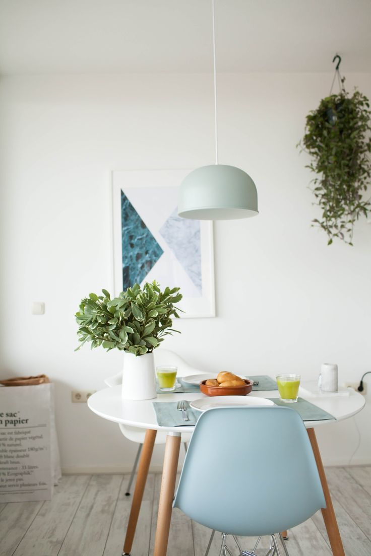 colorful modern dining room. Bright Mid Century Modern Dining Room With Graphic Artwork, White Walls, And Hanging Plants Colorful E