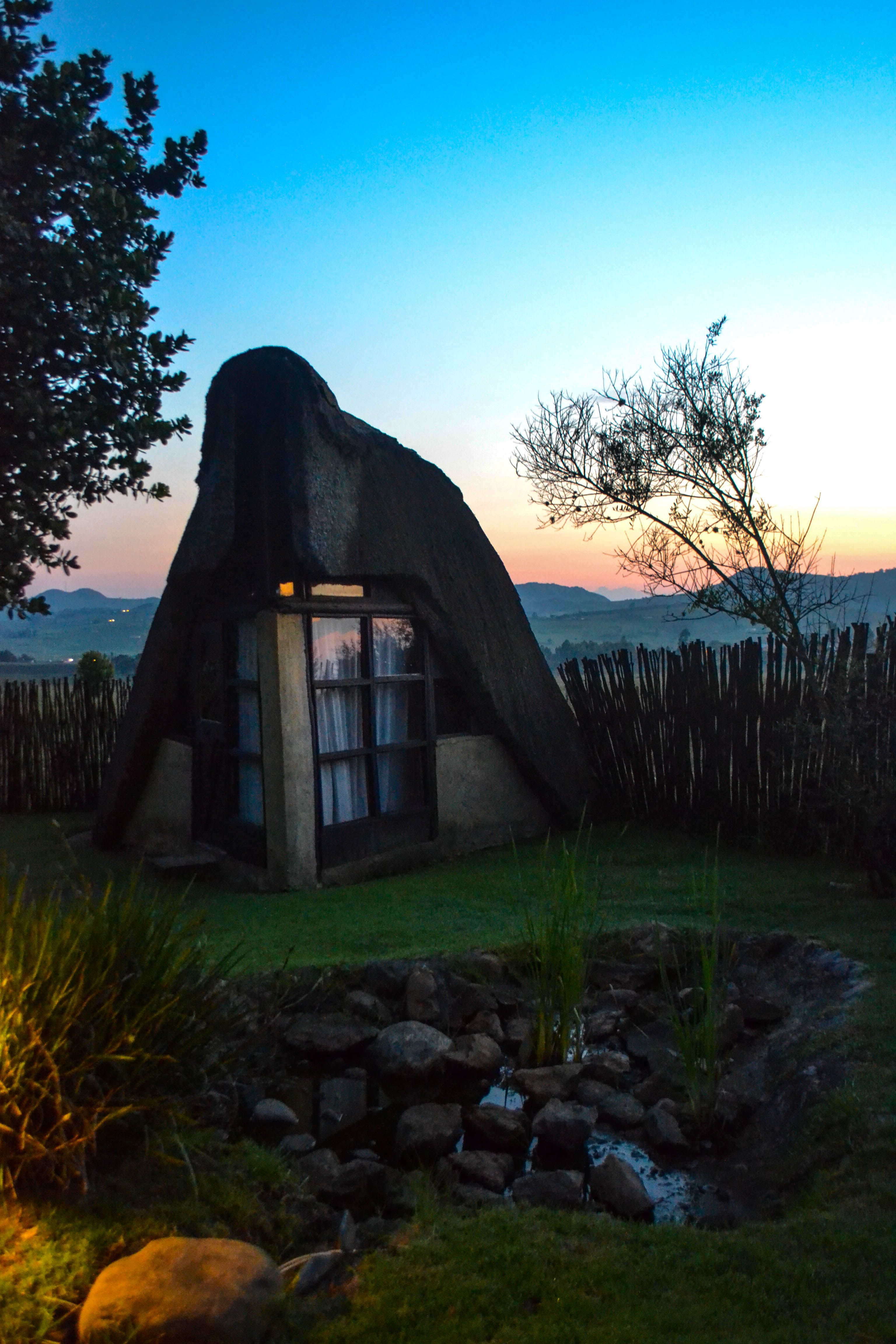 Thatched-roof chalets at Hawane Resort, Swaziland