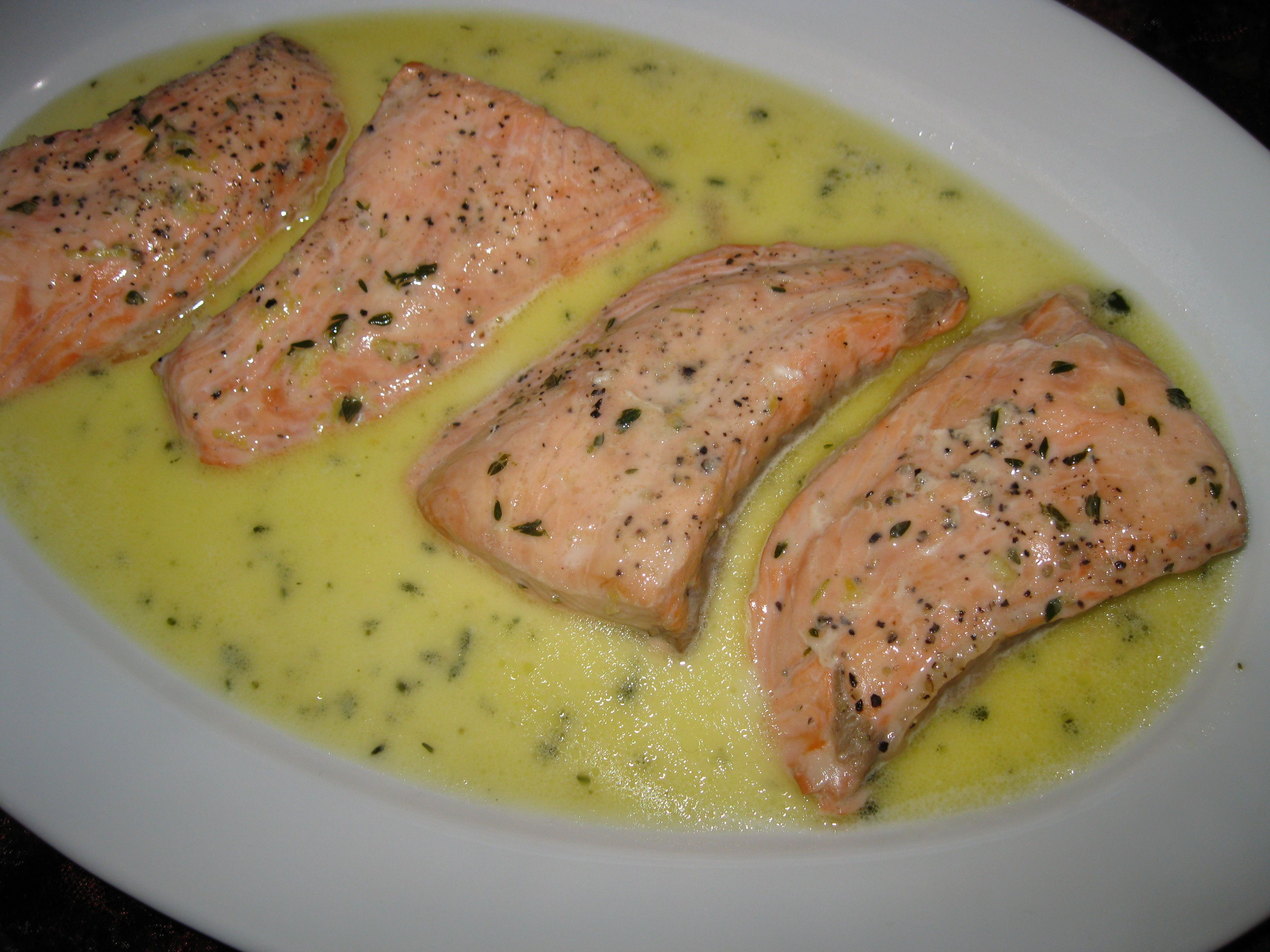 Gin baked salmon with lemon, vermouth and thyme sauce