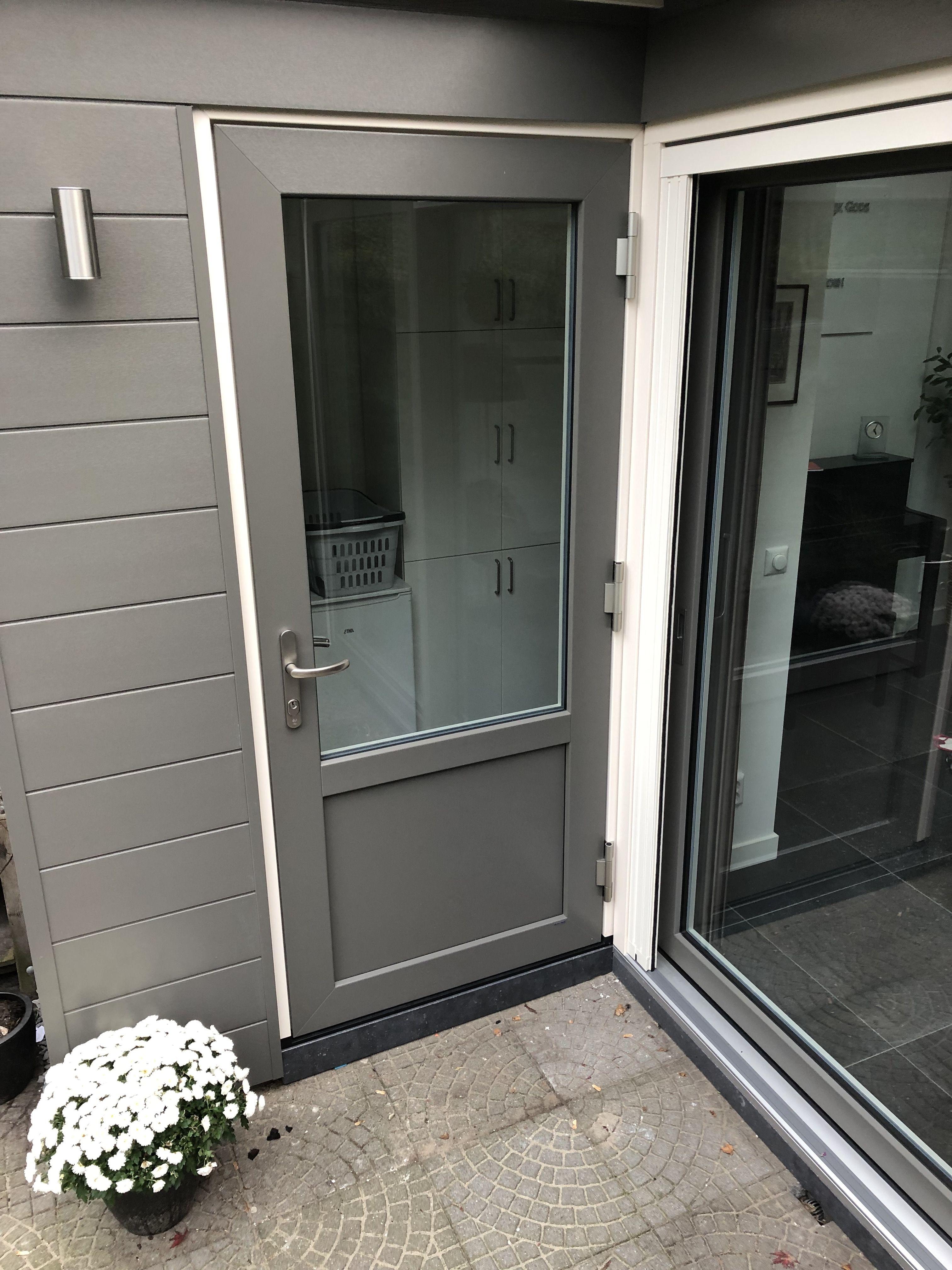 Gray back door in an under construction
