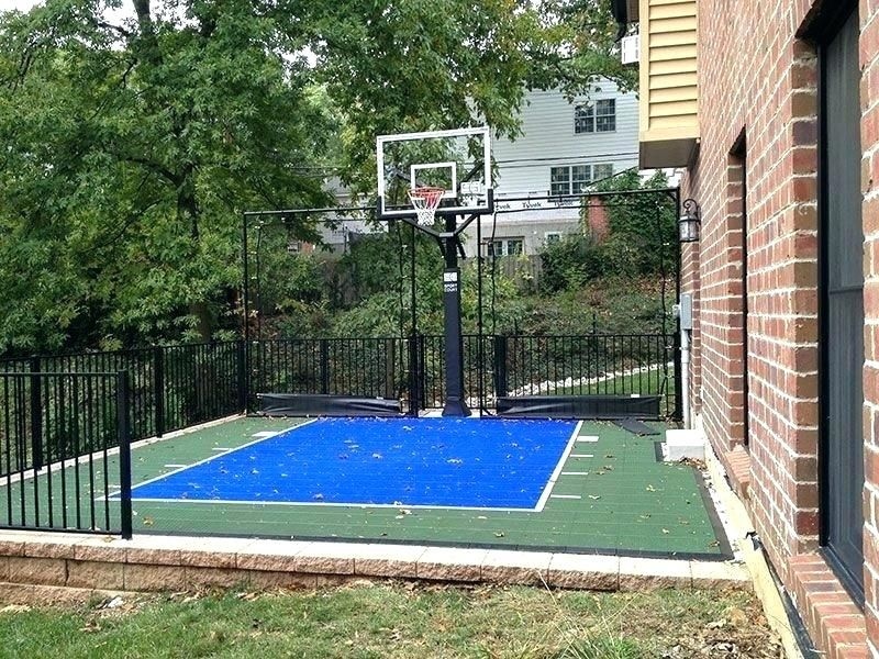 small yard sloping driveway basketball rolling into the ...