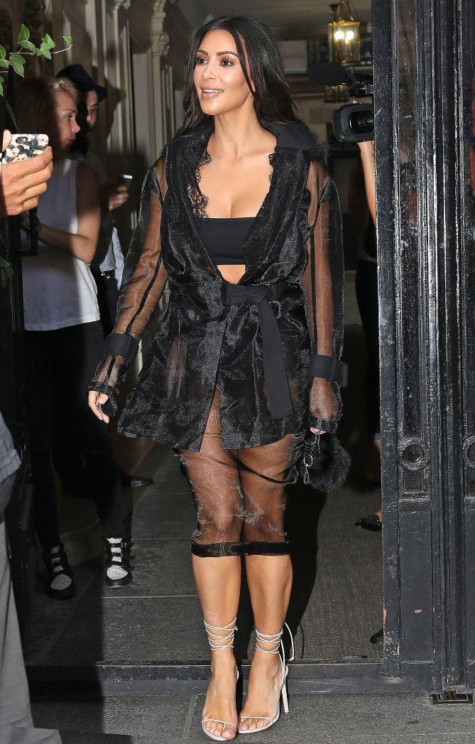 Kim Kardashian s Sexy Paris Fashion Week Outfits - sheer black jacket and  bandeau 2c6379a6d