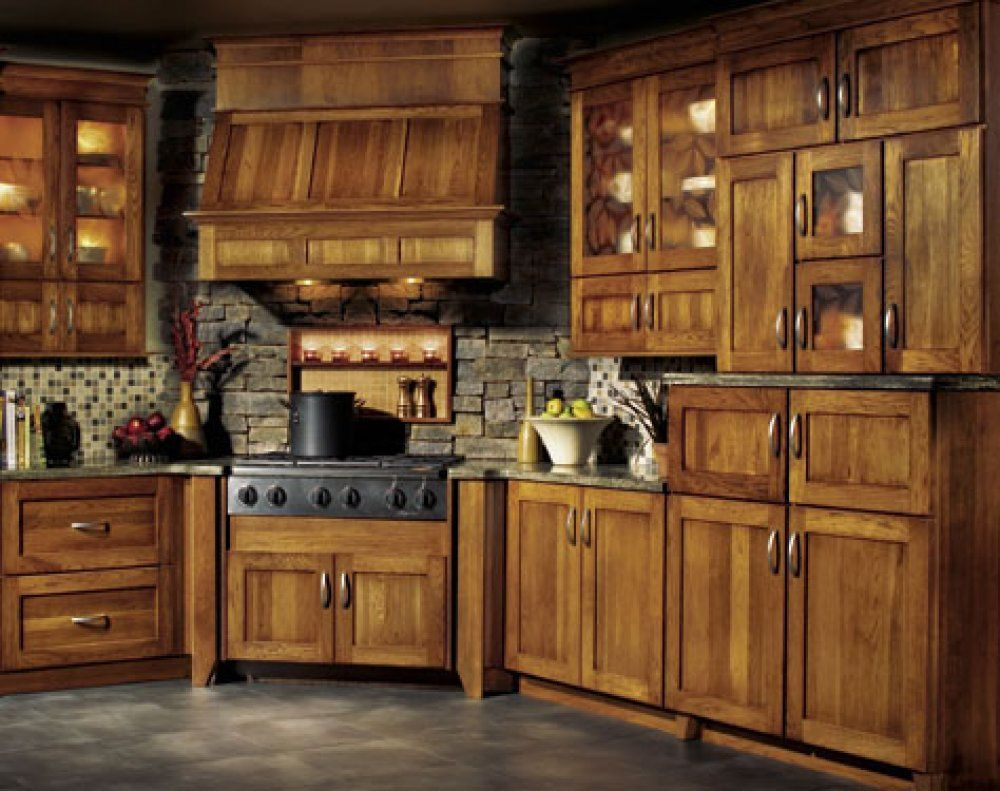 These hickory kitchen look amazing with the stone
