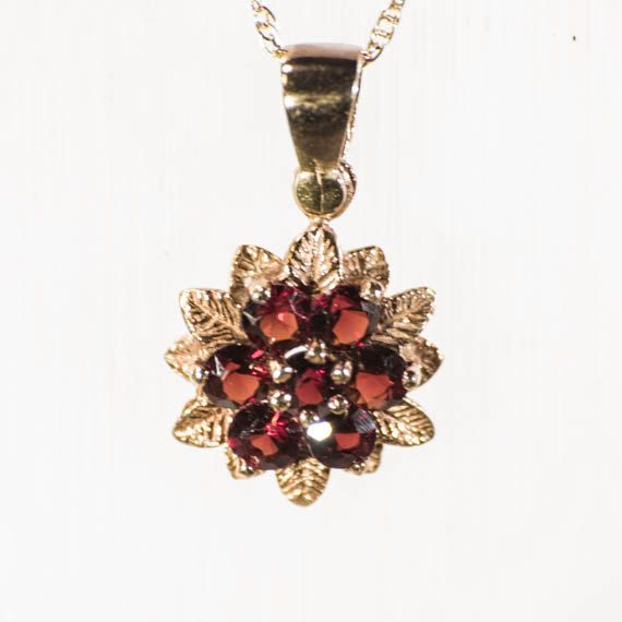 1970s nine carat 9k gold and garnet pendant by TouchstoneVintage