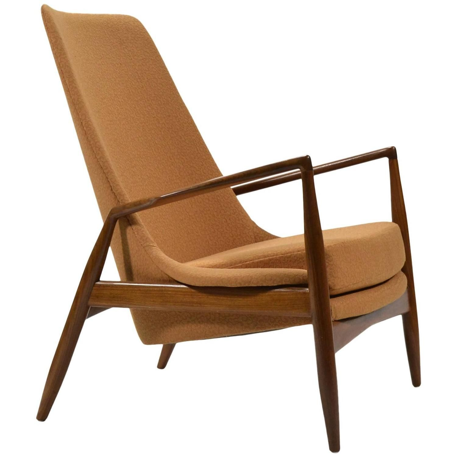 This sculptural pair of lounge chairs by ib kofod larsen is no longer - Ib Kofod Larsen High Back Seal Chair 1