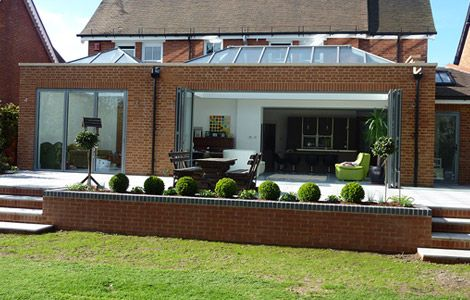 Bi Folds Skylights Combine In This Extension Dontmoveimprovewithelglaze Roof Lantern Raised Patio House Extension Design