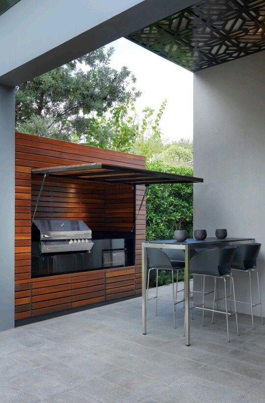 Even The Grill Gets A Posh Hideaway Houzz Com Contemporary Patio Outdoor Bbq Area Outdoor Barbeque