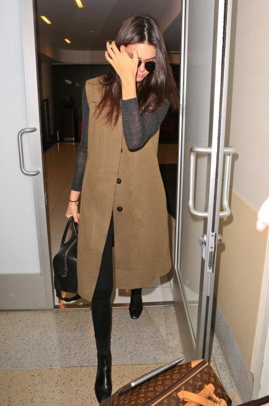 Kendall Jenner wearing Louis Vuitton Monogram Canvas Pegase Suitcase, Givenchy Lucrezia Bag, Saint Laurent Classic 11 Aviator Sunglasses and Sandro Amele Boots