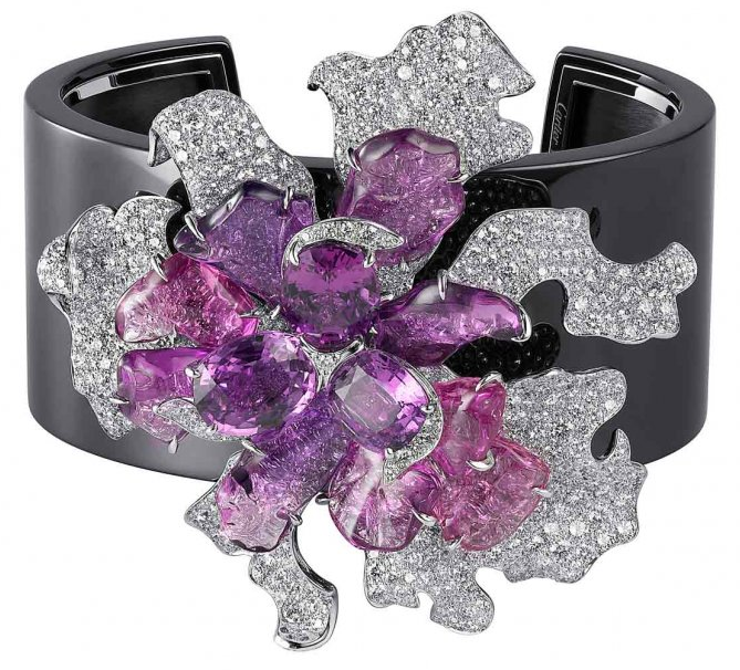 Orchid bracelet from the Cartier Sortilège collection. White gold, diamonds, and pink and purple sapphires. Via Diamonds in the Library.