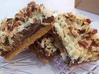 The seven layer magicbar cookie recipecombines the sweetness of chocolate with coconut. It is a perfect dessert cookie recipe. Magic Bar Cookies Ingredients: 1 1/2 cups graham cracker crumbs 1/2 ...