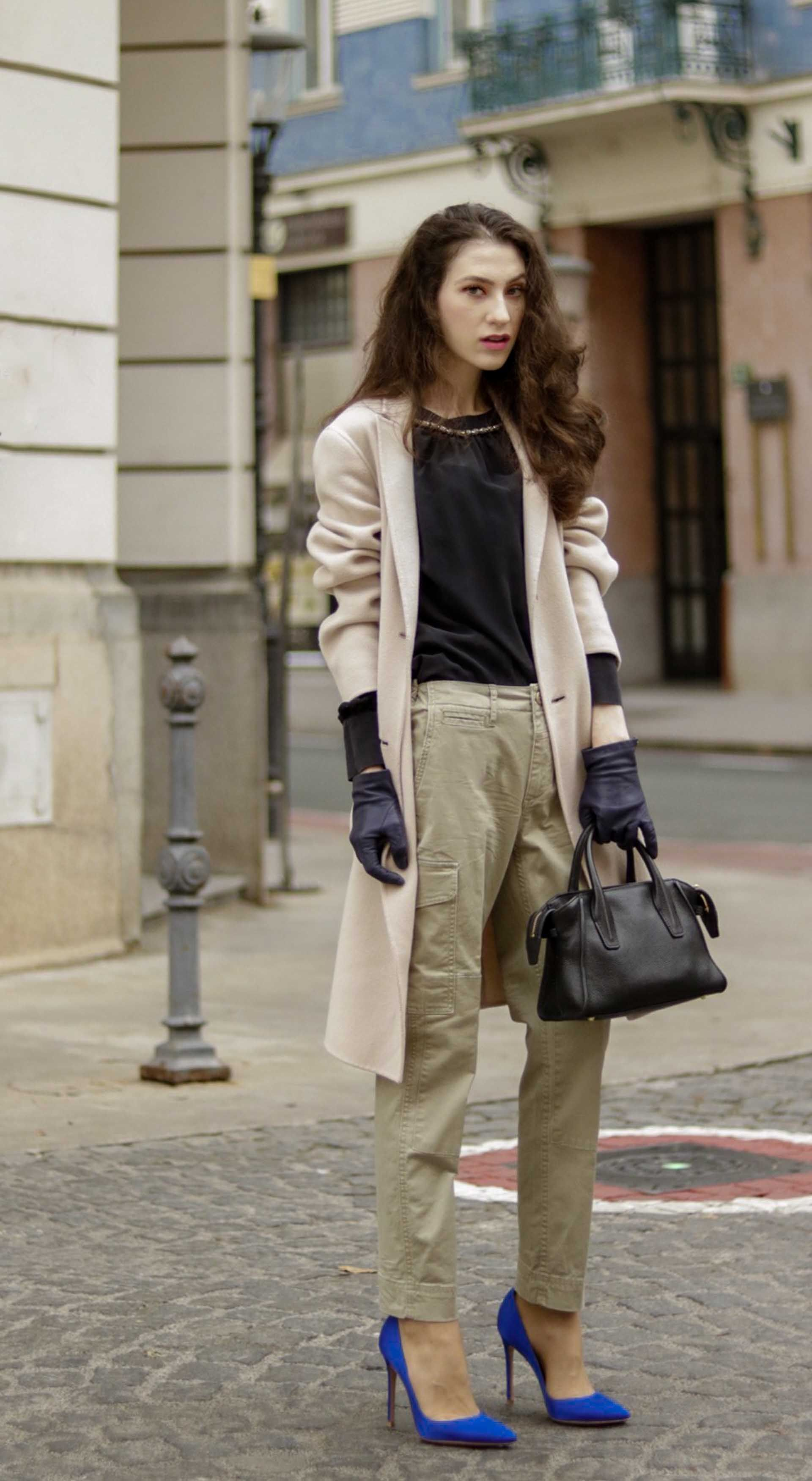 a0bcf299 Beautiful Slovenian Fashion Blogger Veronika Lipar of Brunette from Wall  dressed in Weekend Max Mara double-breasted coat, black silk blouse, ...