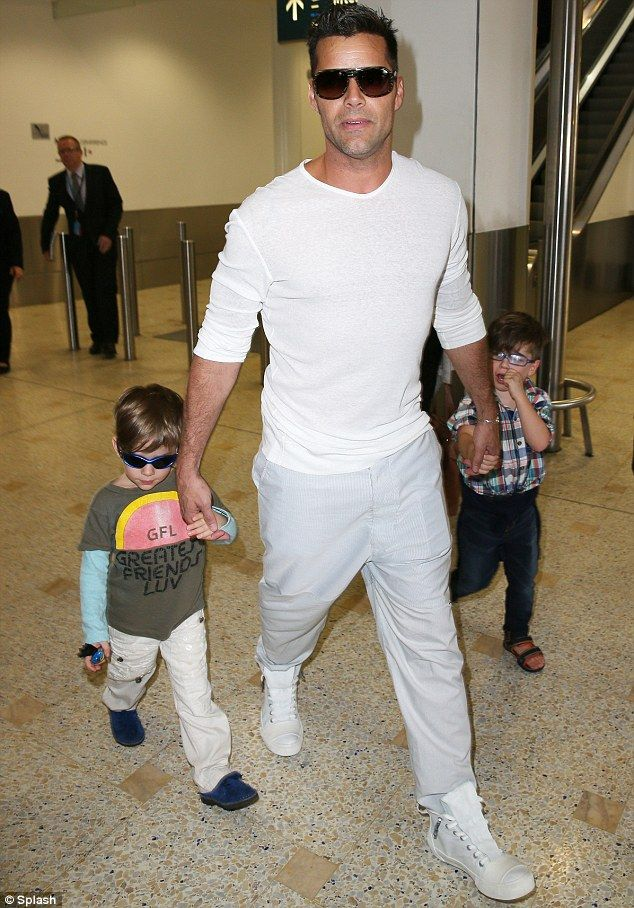 Shake your bon-bon: Ricky Martin looked in a rush as he arrived in Sydney Australia on Tuesday, with his sons Matteo and Valentino