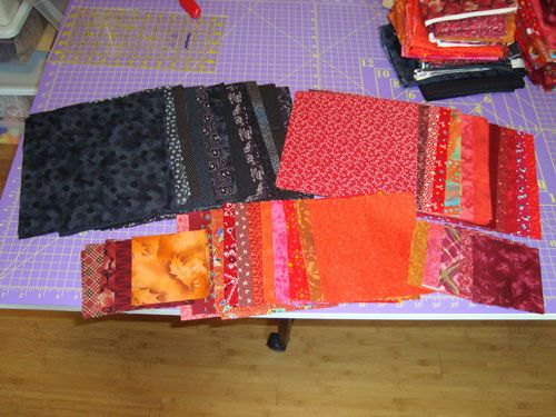 Fabrics cut for the red and black bullseye quilt