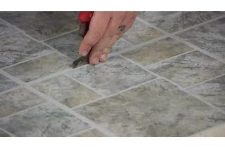 peel stick vinyl tile glue from floor