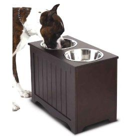 cool pet feeding station raises food and water to prevent back and neck strain also stores. Black Bedroom Furniture Sets. Home Design Ideas