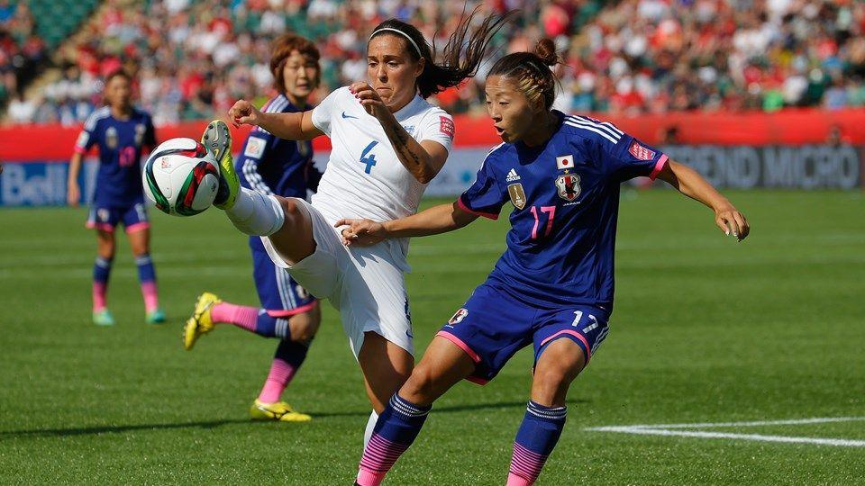 Fara Williams of England battles Yuki Ogimi of Japan