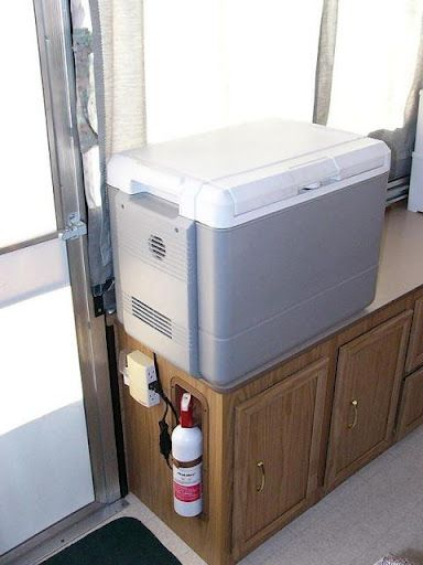 Since our Santa Fe does not offer roof down access to the fridge we always take along this Coleman PowerChill thermoelectric cooler.