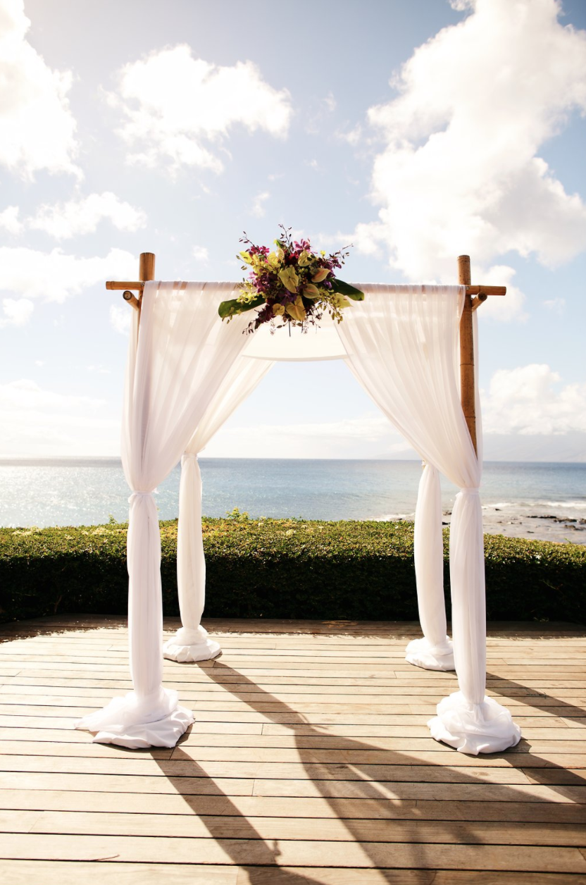 4 Post Bamboo Wedding Canopy With Drape Floral Detail Outside