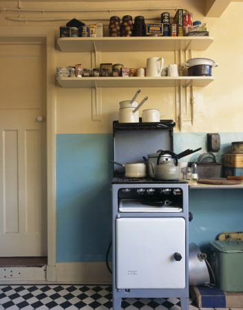 The Kitchen cooker and shelves above at Mendips. This is where John Lennon's Aunt Mimi would cook him his favourite meal of egg and chips washed down with a cup of tea.  ©NTPL/Dennis Gilbert
