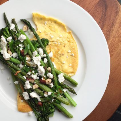 Creamy omelette with sautéed greens