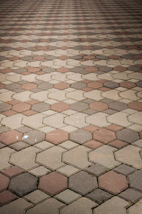 Interlocking paver brick patio design using 3 color schemes