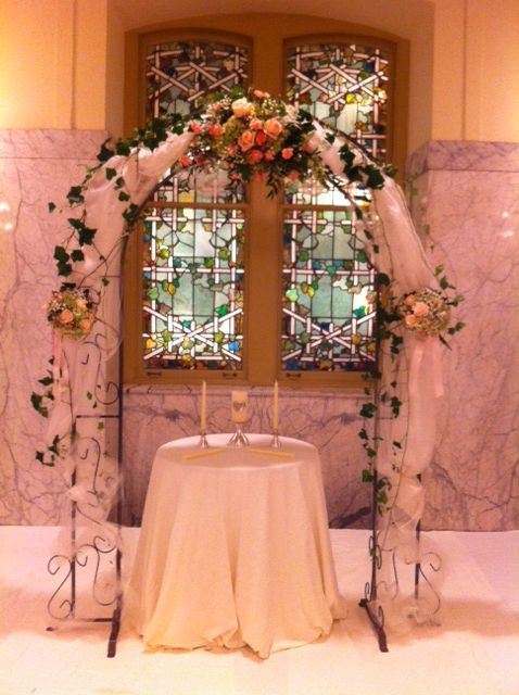 Ceremony arch decorated in fabric and bridal flowers   www.myfloralimpressions.com Floral Impressions 410.329.1406