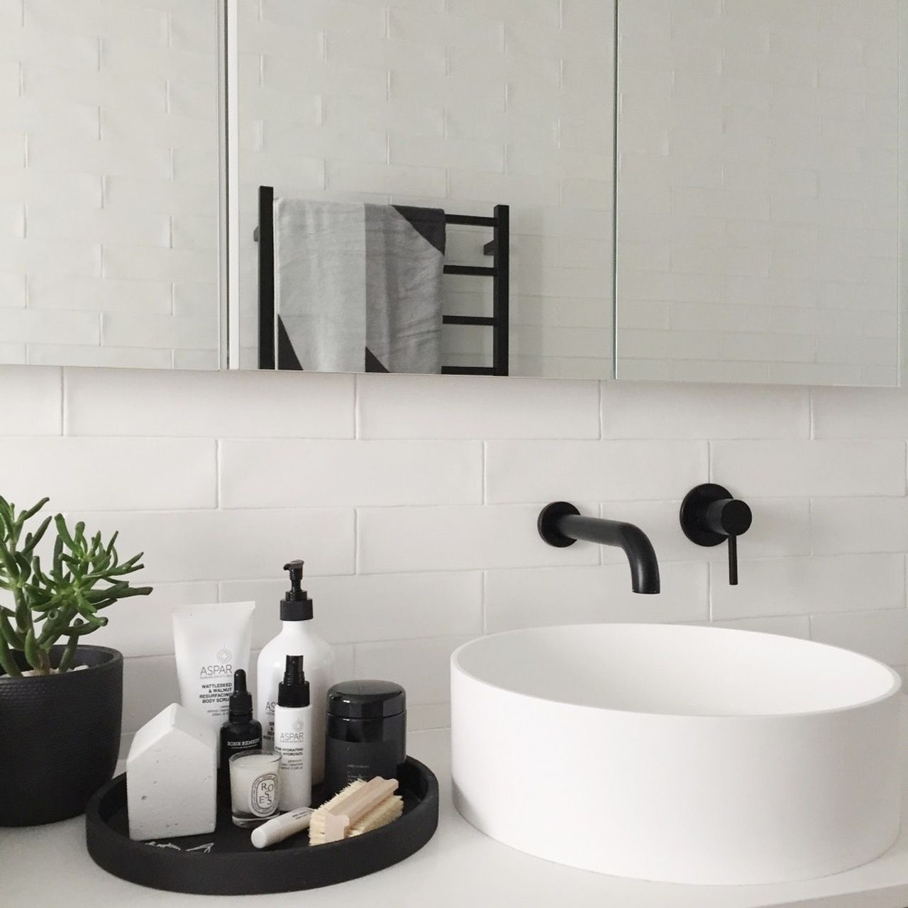 Black and white bathroom styling featuring black