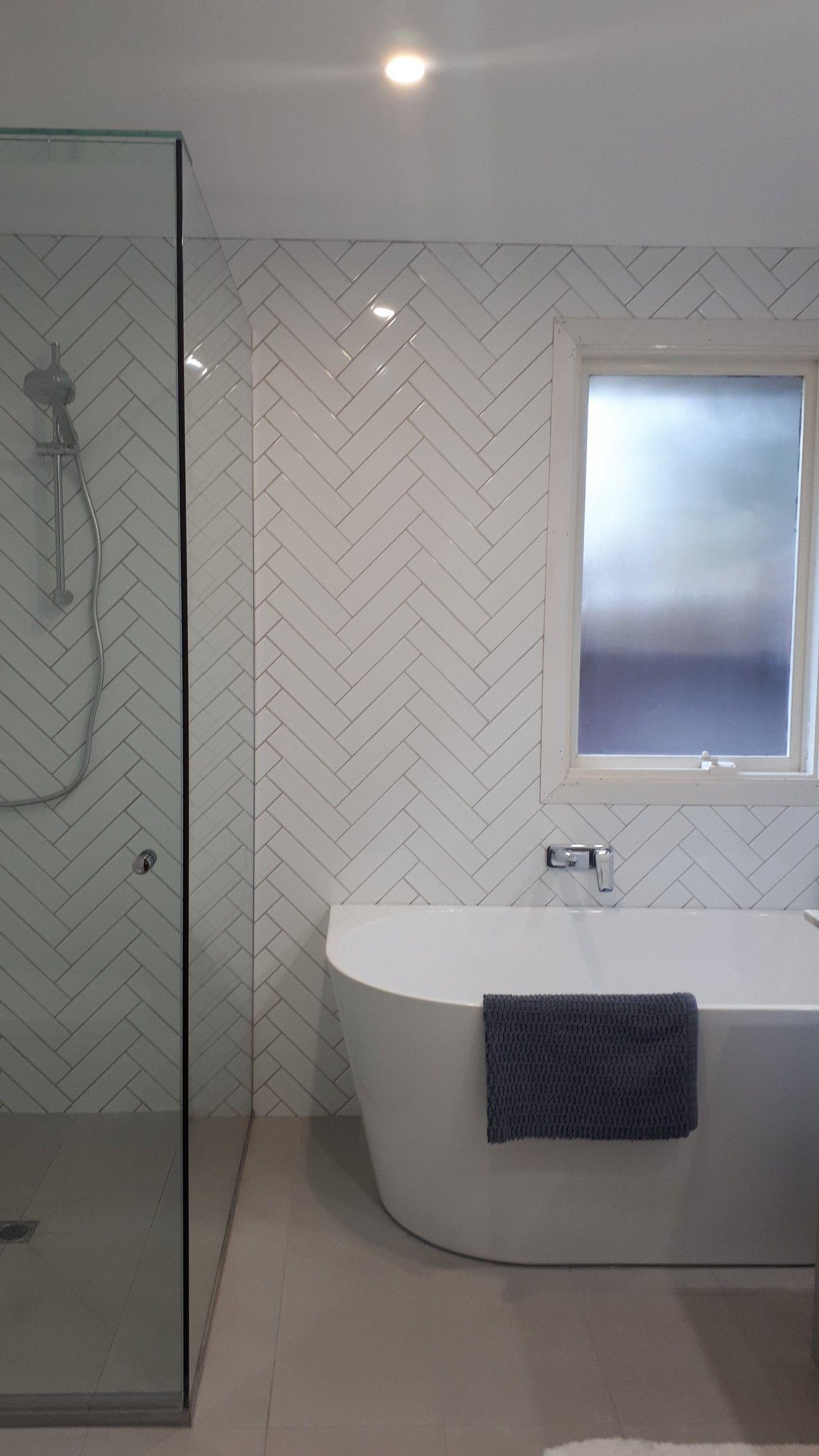 our modern bathroom rebuild white herringbone feature tile