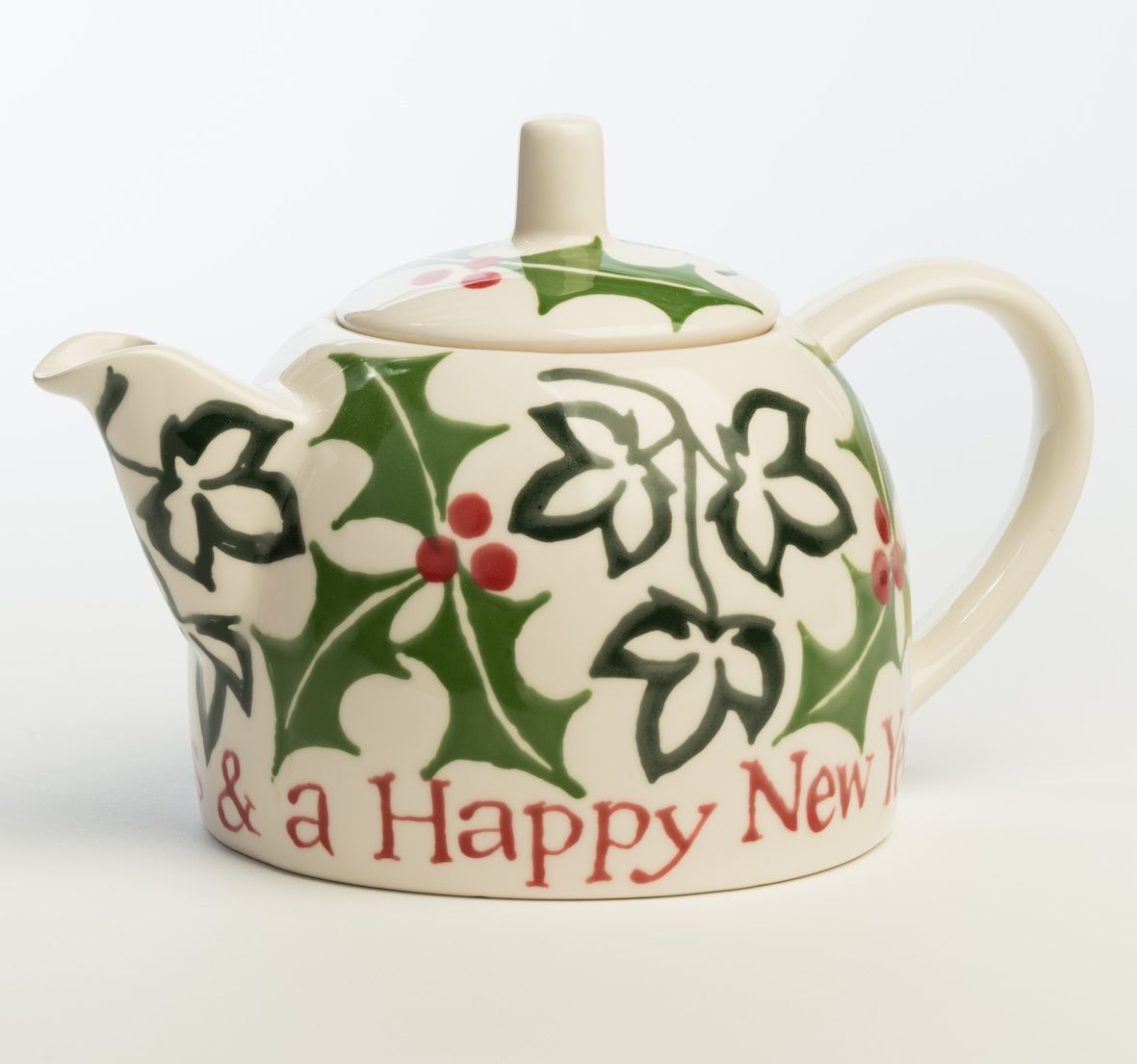 Hannah Berridge Holly and Ivy Christmas Teapot .... dome shape teapot handpainted with ivy and holly leaves and berries, inscribed 'Merry Christmas & a Happy New Year', ceramic, UK