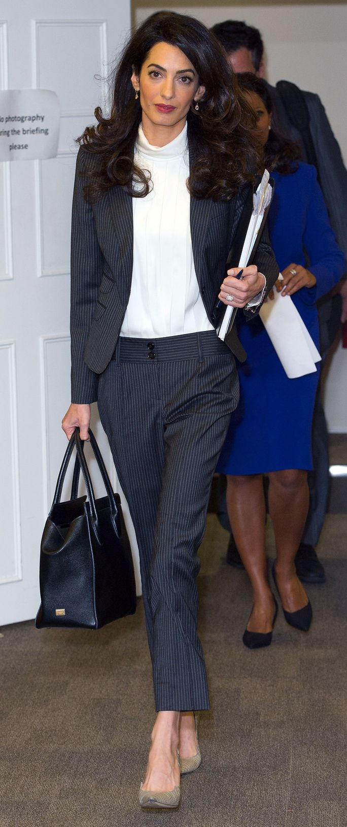 Amal Clooney wowed in a pinstripe suit while hard at work in London.