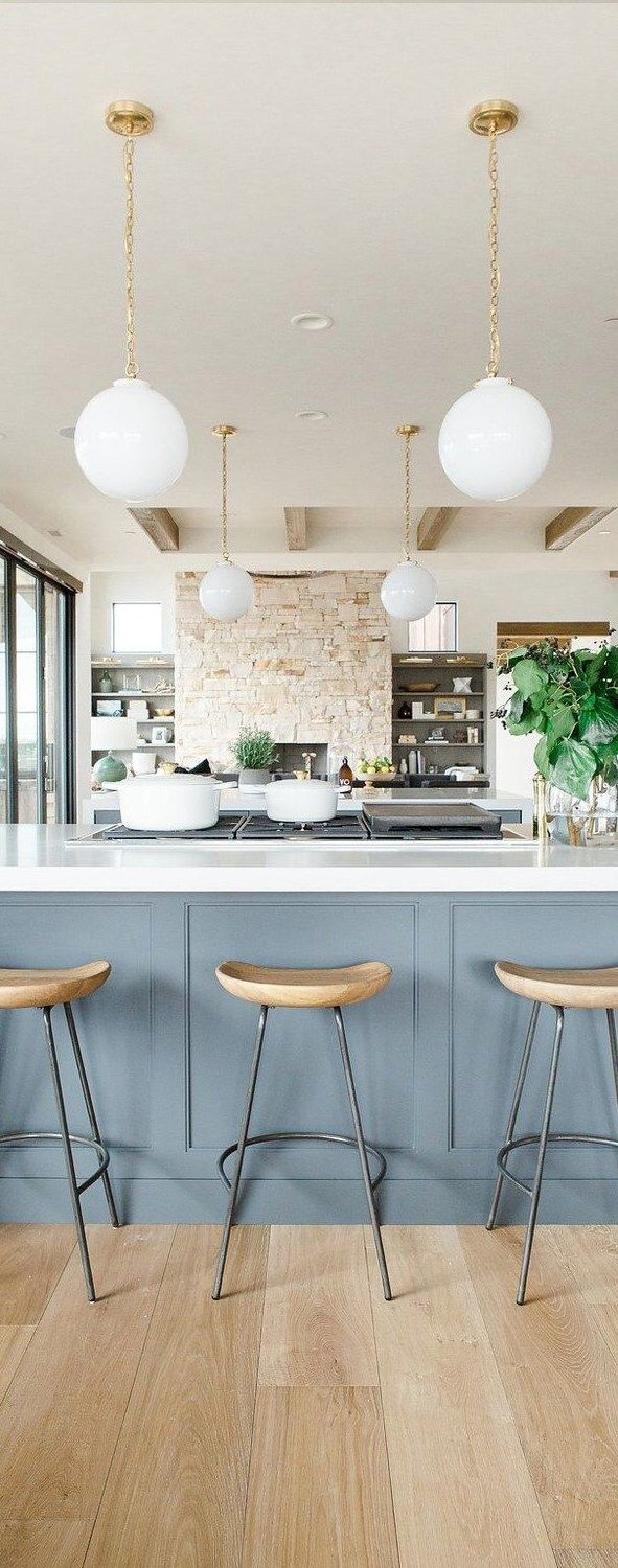 Modern Kitchen With Open Shelves Natural Wood Barstools Blue Cabinets White Waterfall Edged Countertops
