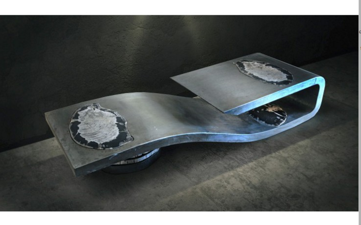 """""""Balance"""" Size: 75''x25''x16''  Inspired by the natural order and divine balance, this one-of-a-kind sculptural coffee table is crafted from steel and petrified wood.  In 2010 Brevard designed and welded this utterly unique piece.   http://johnbrevard.com/balance"""