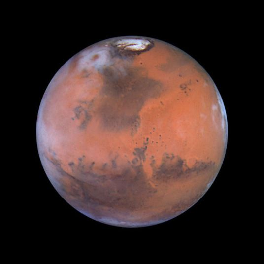 Undated file photo of Mars, as seen by the Hubble Space Telescope. A close encounter of the Martian kind was due to occur Wednesday June 13 2001, and could trigger a flood of UFO reports. Mars was heading towards its closest approach to Earth in more than a dozen years. The planet will be approximately 42 million miles away close enough for the polar ice caps to be seen through a small telescope.