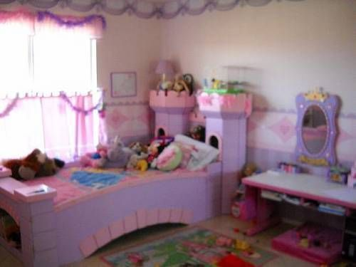 Princess themed bedroom with pink purple castle bed for for Castle bedroom ideas