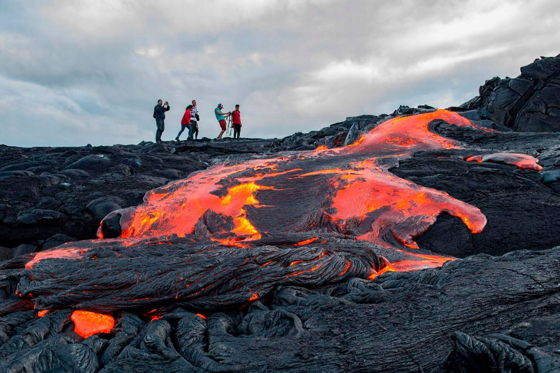 Daring tourists hike up active volcano to get as close as possible ...