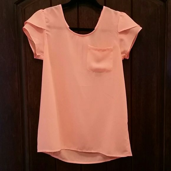 NWT Neon peach blouse NWT Neon peach blouse. Blouse is sheer has a front pocket, flirty sleeves,  and a zipper on back. Tops Blouses