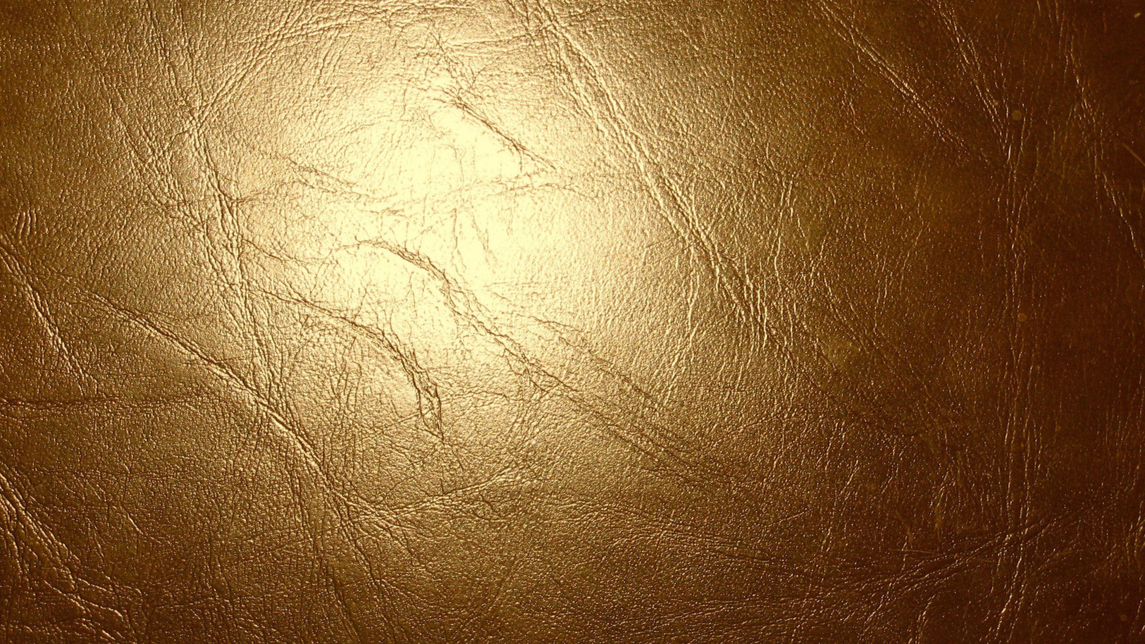 3840x2160 Wallpaper leather, gold, glitter, cracks