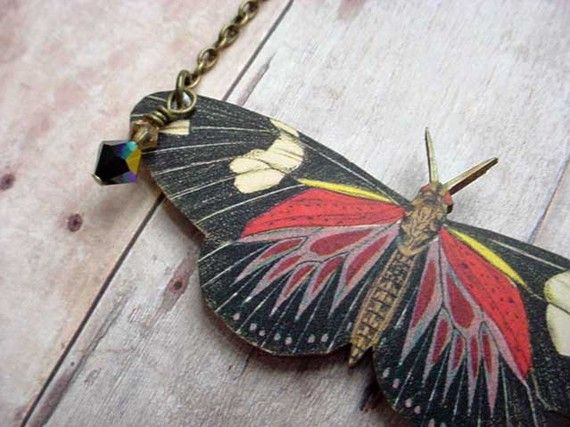 Hey, I found this really awesome Etsy listing at https://www.etsy.com/listing/61940007/red-and-black-moth-pendant-large
