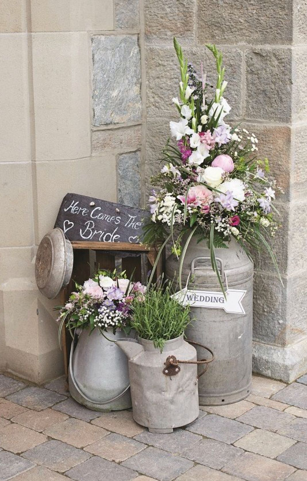 Pin by princeton flower gift shop on weddings pinterest rustic wedding for a rustic feel display herbs and flowers in milk churns izmirmasajfo