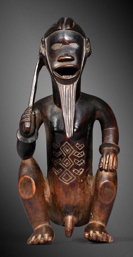 Africa | Statuette of 'a seated male figure from the Bembe people of DR Congo | Wood | ca. 1903 or earlier