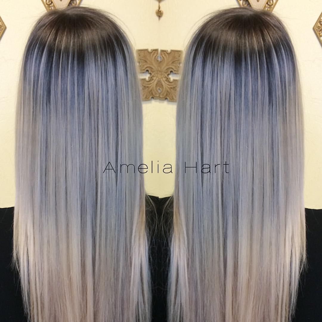 A deep dark shadow root melting to cool platinum ends seamless to
