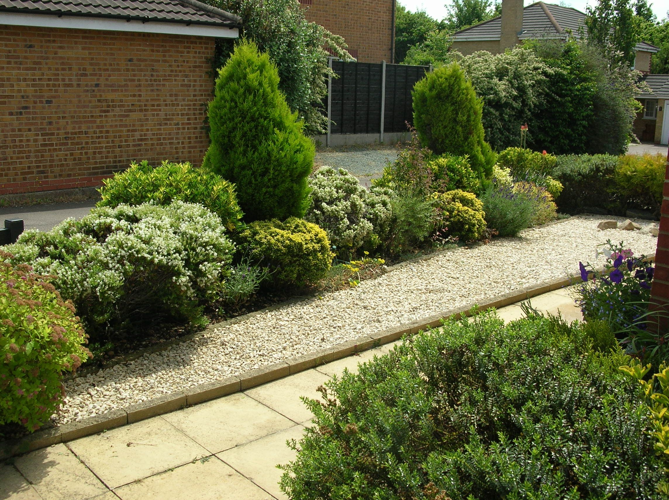 Cotswold chippings used in garden border to complement green shrubs cotswold chippings used in garden border to complement green shrubs and plants workwithnaturefo