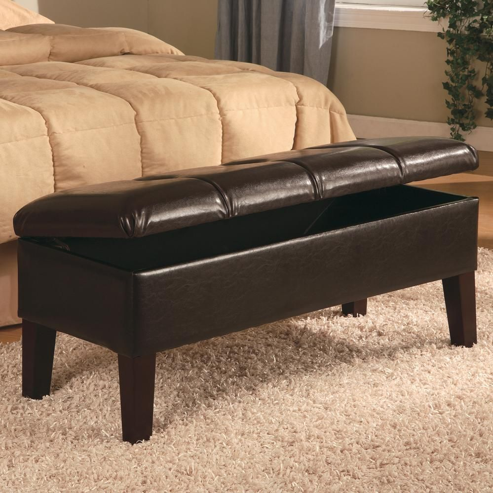 A storage bench with button tufted seat in a deep brown leather