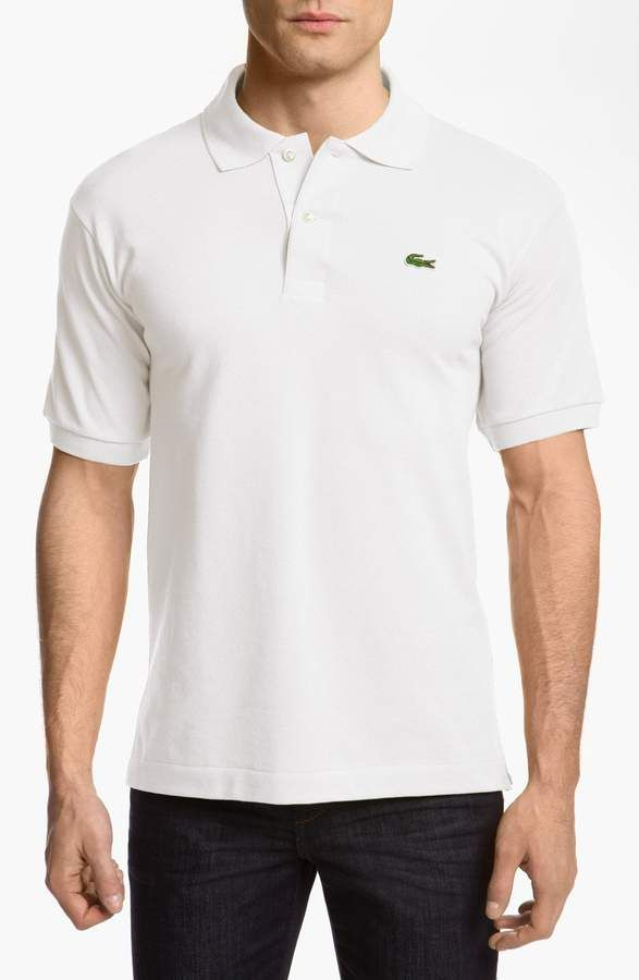 bd97f0f5df2 Free shipping and returns on Lacoste L1212 Regular Fit Piqué Polo at  Nordstrom.com. Classic piqué polo has banded sleeves and side vents at the  open hem.