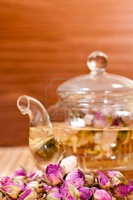 Pink rose tea on bamboo mat and wood background