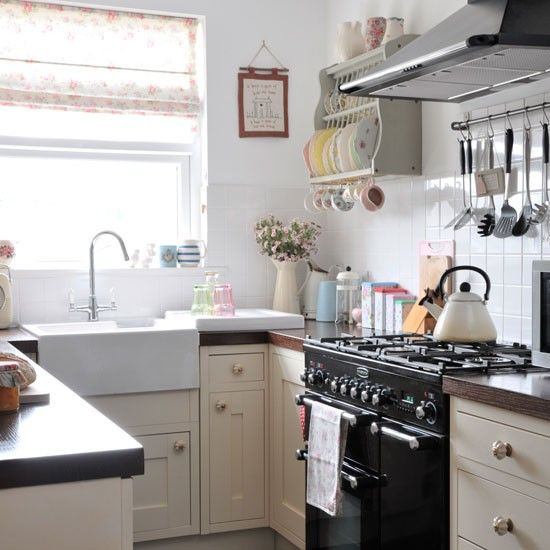 Real homes vintage style victorian house photo for Small country kitchen ideas