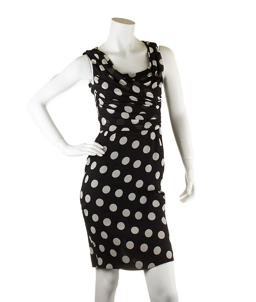 This Size 40 Dolce & Gabbana Black & White Polka Dot Silk Dress is now available on our website for $75.00. Check out our collection of authentic Dolce & Gabbana items at http://cashinmybag.com/?s=dolce+%26+gabbana&post_type=product. Our merchandise does sell very quickly. But don't worry, new items are listed daily.