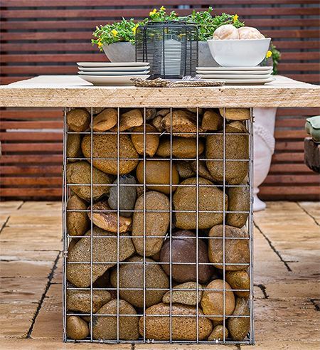 Home-Dzine - Gabion-style outdoor table set - This gabion-style outdoor table and benches is easy enough to make and if you have all the steel mesh cut to size, assembly is quick and easy. Top off the benches and table with reclaimed wood, railway sleepers or stone for a garden set that is raw and stylish with a contemporary feel. - See more at: http://www.home-dzine.co.za/garden/garden-gabion-set.htm#sthash.qJPwTp5R.dpuf