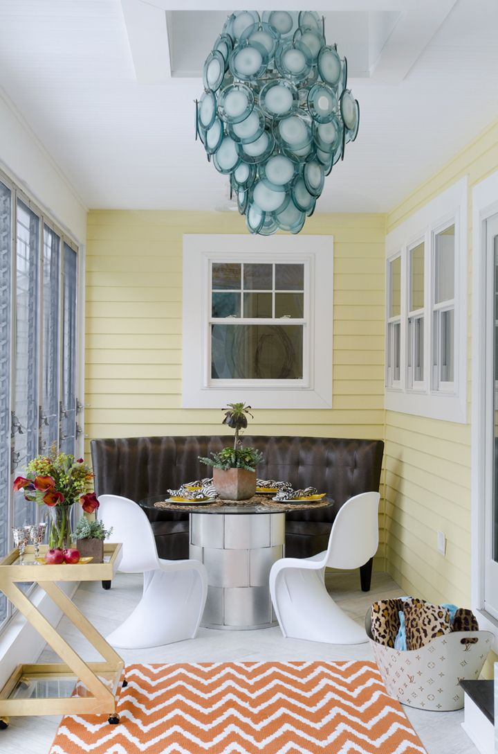 porch dining area with turquoise chandelier