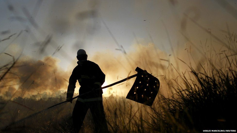 Soldiers fight a fire in a forest reserve in northern Brasilia, Brazil.